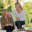 Mother and daughter chatting at home — Stok fotoğraf