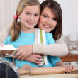 Little girl with rolling pin — Stock Photo