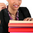 Businesswoman with a pile of folders — Stock Photo #7955826