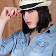 Stock Photo: Woman wearing a Panama hat