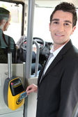 Commuter swiping his tram ticket — Stok fotoğraf