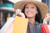 Portrait of a smiling woman doing shopping — Stock Photo