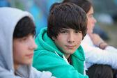 Three teenagers sat together — Stock Photo