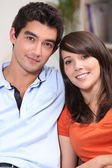 Head and shoulders of a young attractive couple — Stock Photo