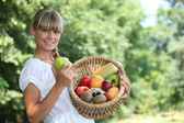 Woman with fruit basket — Stock Photo