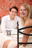 Man and woman dining at a restaurant — Stock Photo