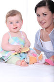 Portrait of a young mum and baby girl — Stock Photo