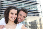 Couple in build up area — Stock Photo