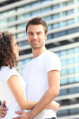 Young couple stood outside — Stock Photo