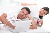 Woman surprising boyfriend with gift — Stock Photo