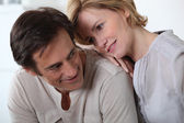 A woman fixing her smiling companion with a devoted look. — Stock Photo
