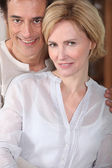 Man and woman smiling — Stock Photo