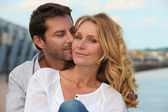 Portrait of a couple by the sea — Stock Photo