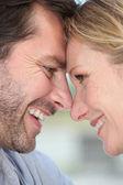 Closeup of a loving couple touching heads — Stock Photo
