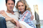 Relaxed mature couple sitting in the sunshine — Stock Photo