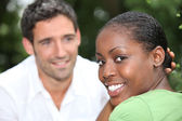 Smiling mixed race couple — Stock Photo