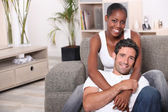 Happy mixed couple at home — Stock Photo