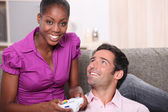 Man and woman entertaining playing video games — Stock Photo