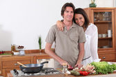 Couple preparing dinner in the kitchen — Stock Photo