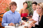Young couple having a meal in a restaurant together — Stock Photo