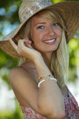 Woman wearing summery straw hat — Stock Photo