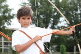 Boy with a bow and arrow — Stock Photo