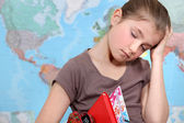 Bored girl falling asleep at school — Stock Photo