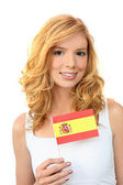 Attractive woman holding a Spanish flag — Stock Photo