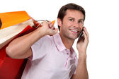 Portrait of a man with shopping bags — Stock Photo