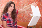 Woman disgusted by her laptop — Stock Photo