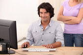 A man doing computer and an angry woman — Stock Photo