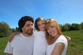 Happy family enjoying a day out in the sunshine together — Stock Photo