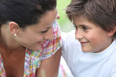 Mother and son at park — Stock Photo