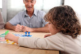 Young child playing a board game — Stock Photo