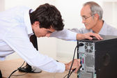 Technician repairing a computer — Stock Photo