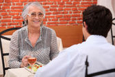 Grand ma is buying me lunch. — Stock Photo