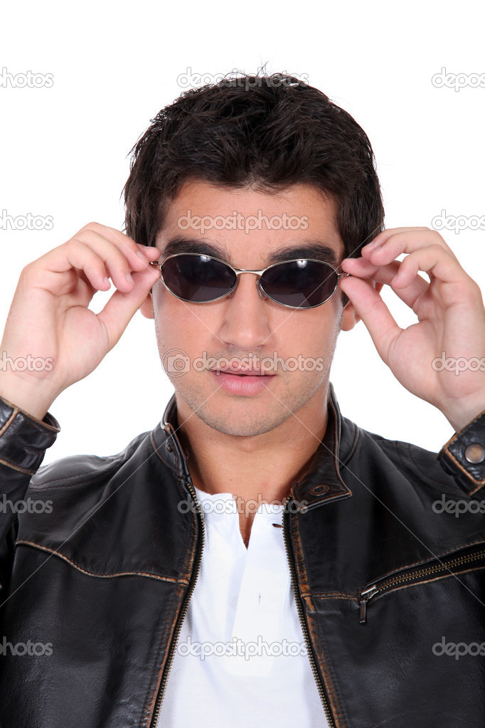 Handsome man wearing leather jacket and sunglasses  Stock Photo #7951361