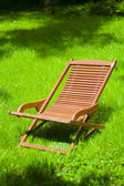 Chaise longue in the grass — Stock Photo