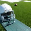 Royalty-Free Stock Photo: Football Helmet on the Bench