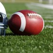 Football and Helmet on the Field — Stock Photo #6894155