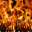Flame of a Barbecue - Stock Photo