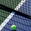 Royalty-Free Stock Photo: Tennis Ball in the Shadow of the Net
