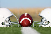 American Football with Helmets on the Field — Stock Photo