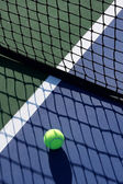 Tennis Ball in the Shadow of the Net — Stock Photo