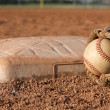 Royalty-Free Stock Photo: Baseball and Glove near a Base