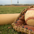 Royalty-Free Stock Photo: Baseball in a glove with bat