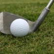 Foto Stock: Golf Ball and Wedge