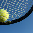 Tennis Ball on a Racket - Stockfoto