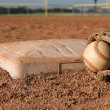 Baseball and Glove near Second Base — Stock Photo