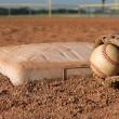 Baseball and Glove near Second Base — Stock Photo